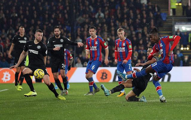Crystal Palace's Wilfried Zaha smashes home the equaliser (Nigel French/PA Wire.)
