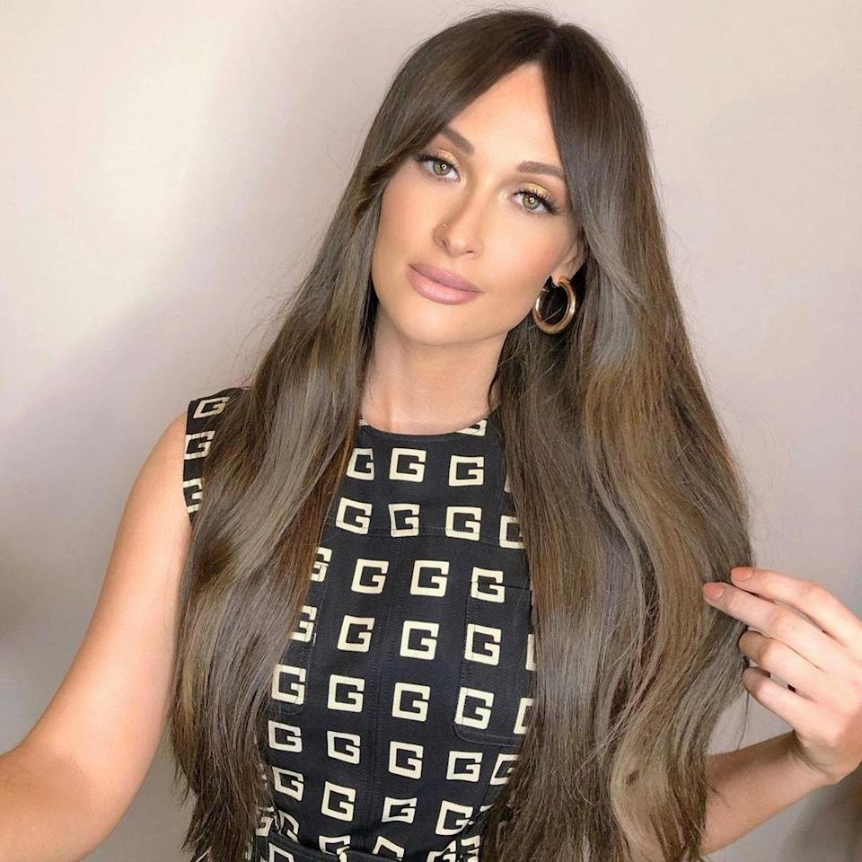 """Even if you're a cool-toned brunette, warm highlights can still boost your color. Kacey Musgraves's stylist <a href=""""https://www.instagram.com/giovannidelgado/"""" rel=""""nofollow noopener"""" target=""""_blank"""" data-ylk=""""slk:Giovanni Delgado"""" class=""""link rapid-noclick-resp"""">Giovanni Delgado</a> updated her typically jet-black hair with a cool brown hue and some golden highlights. <br> <br> """"What's interesting about fall hair is that it tends to follow cues from everything else people are changing up — chunkier texture sweaters, hats, scarves, etc.,"""" notes <a href=""""https://www.instagram.com/shvonneperkins/"""" rel=""""nofollow noopener"""" target=""""_blank"""" data-ylk=""""slk:Shvonne Perkins"""" class=""""link rapid-noclick-resp"""">Shvonne Perkins</a>, manager of training and education at Madison Reed. """"These tone adjustments make the hair appear richer, juicier, and more reflective against the more muted colors of a fall wardrobe."""""""
