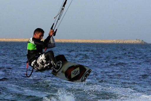 A Libyan man practices kitesurfing off the coast of Tripoli on December 8, 2012