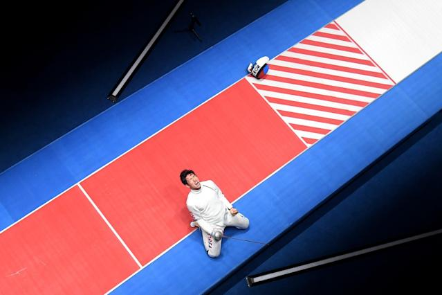 <p>Sangyoung Park of Korea celebrates after defeating Geza Imre of Hungary during the gold medal medal bout in the Men's Epee Individual on Day 4 of the Rio 2016 Olympic Games on August 9, 2016 in Rio de Janeiro, Brazil. (Photo by Richard Heathcote/Getty Images) </p>