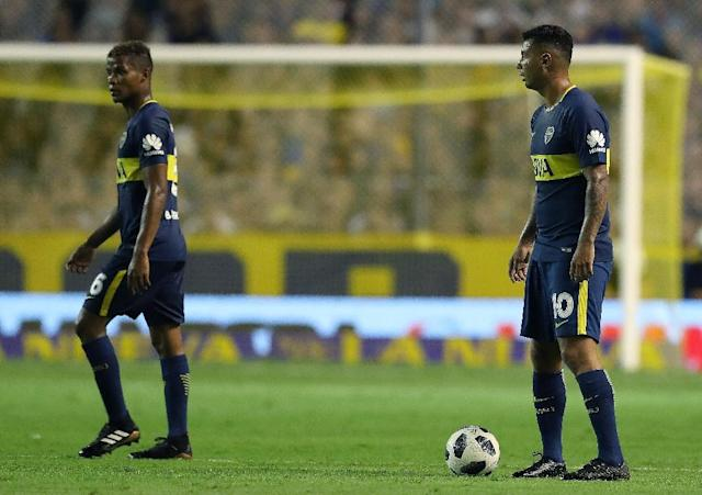 Colombians midfielders Edwin Cardona (R) and Wilmar Barrios, who play for one of Argentina's storied teams, Boca Juniors, are accused of assaulting and threatening two women (AFP Photo/ALEJANDRO PAGNI)