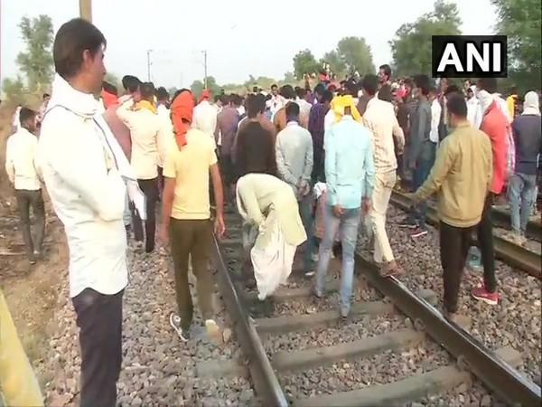 Members of Gurjar Community gather at railway track in Bharatpur to demand reservation. Photo/ANI
