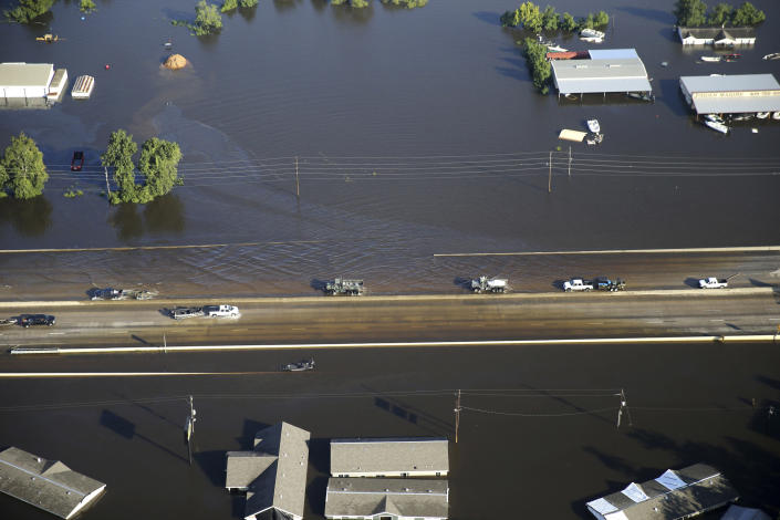 <p>Vehicles drive on Interstate 10 which was flooded from Tropical Storm Harvey in Vidor, Texas, Thursday, Aug. 31, 2017. (Photo: Gerald Herbert/AP) </p>
