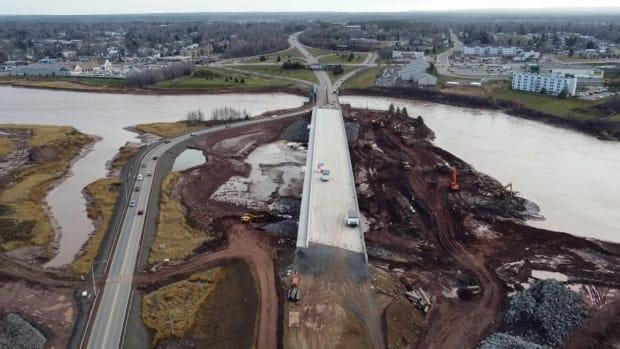 Construction on the new bridge that will replace the Petitcodiac River causeway shown in December 2020.