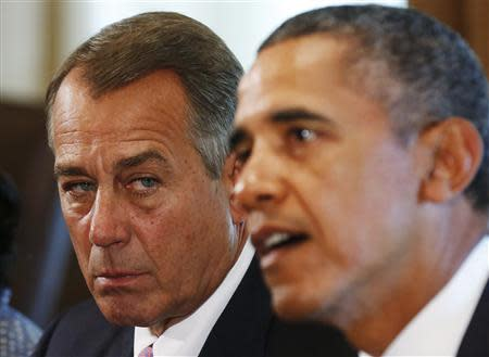 Speaker of the House John Boehner (R-OH) (L) listens to U.S. President Barack Obama during a meeting with bipartisan Congressional leaders in the Cabinet Room at the White House in Washington to discuss a military response to Syria, September 3, 2013. REUTERS/Larry Downing