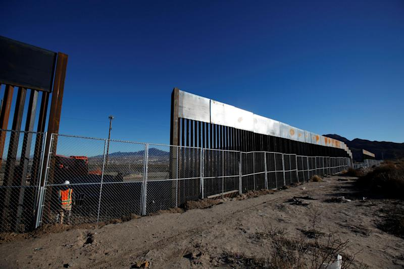 A worker stands next to a newly built section of the U.S.-Mexico border fence at Sunland Park, U.S. opposite the Mexican border city of Ciudad Juarez, Mexico: REUTERS/Jose Luis Gonzalez