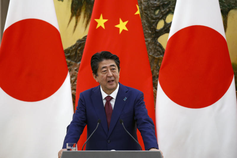Japanese Prime Minister Shinzo Abe speaks during a joint press conference with Chinese Premier Li Keqiang at the Great Hall of the People in Beijing, Friday, Oct. 26, 2018. (AP Photo/Andy Wong)