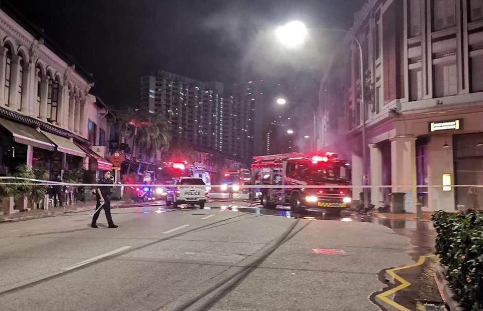 A stretch of Tanjong Pagar Road being cordoned off, after a car crashed into the front of a shophouse on 13 February 2021. (PHOTO: Courtesy of Song Seng Wun)