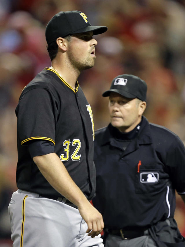 Pittsburgh Pirates relief pitcher Vin Mazzaro (32) walks off the field after giving up the winning run against the Cincinnati Reds in the 13th inning of a baseball game, Wednesday, June 19, 2013, in Cincinnati. Cincinnati won 2-1. (AP Photo/Al Behrman)