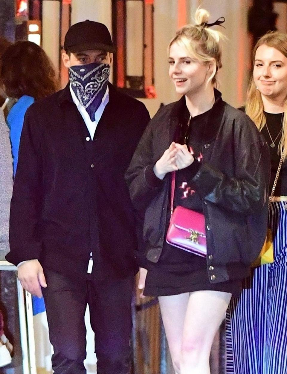 <p>Rami Malek and girlfriend Lucy Boynton step out for a bite to eat in London's Soho neighborhood on Thursday. </p>