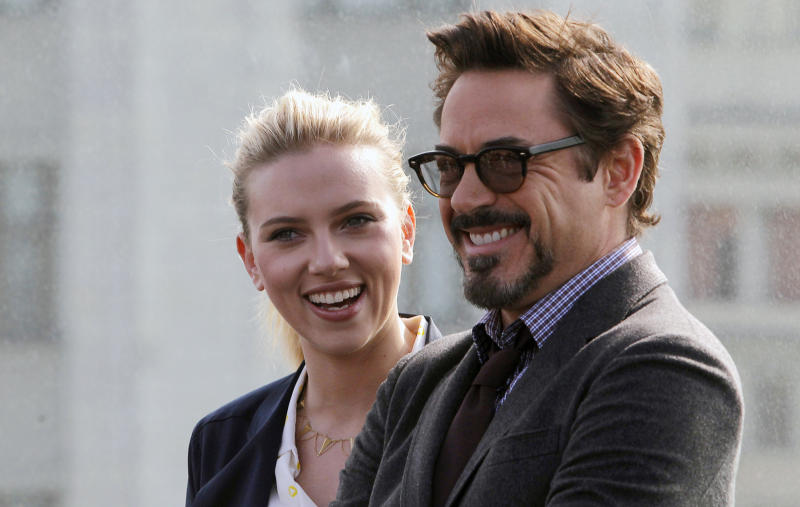 "Actress Scarlett Johansson, left, and Actor Robert Downey Jr., pose for photographers at a hotel during a photocall for the film ""Marvel"" in Moscow, Russia, Tuesday, April 17, 2012. (AP Photo/Misha Japaridze)"