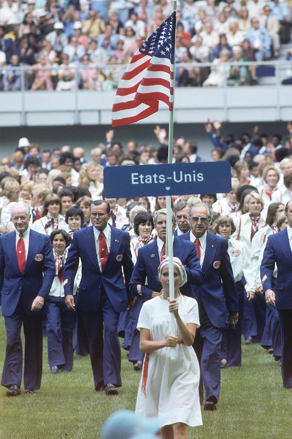 <p>In 1976, Halston — known for his disco-era looks — outfitted Team USA for the winter and summer Olympics. The sleek suits with wide-legged trousers made the Olympians look like they really meant business. And Halston also designed women's white zip-up jackets with an oh-so-'70s collar and red, white and blue neck scarf. </p>