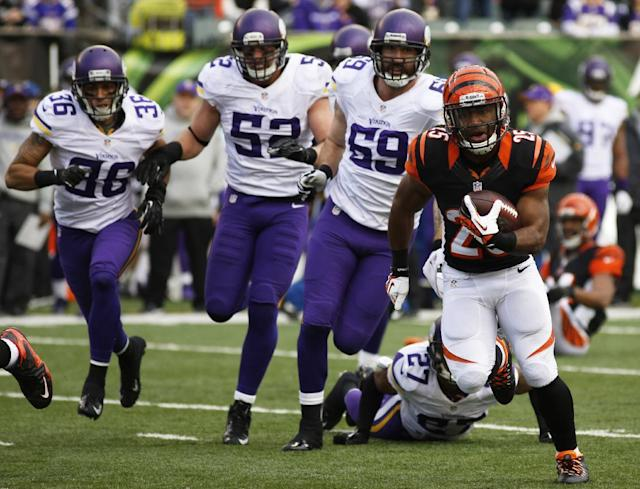 Cincinnati Bengals running back Gio Bernard (25) runs away from Minnesota Vikings safety Robert Blanton (36), outside linebacker Chad Greenway (52) and outside linebacker Desmond Bishop (59) during the second half of an NFL football game, Sunday, Dec. 22, 2013, in Cincinnati. Cincinnati won 42-14. (AP Photo/David Kohl)