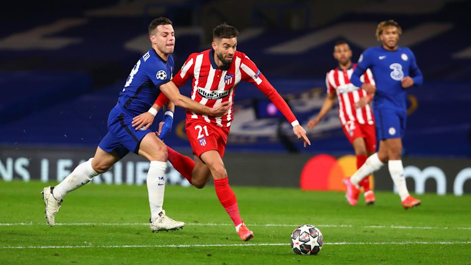 Yannick Ferreira Carrasco goes down after a challenge by Cesar Azpilicueta during the UEFA Champions League Round of 16 match.