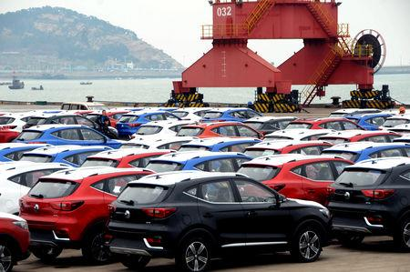 FILE PHOTO: Cars waiting to be exported are seen at a port in Lianyungang