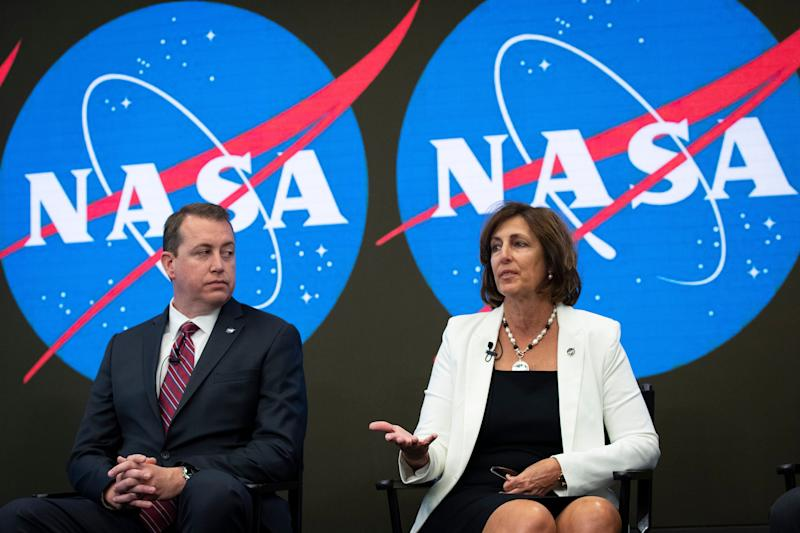 NEW YORK, NY - JUNE 7: (L-R) NASA Chief Financial Officer Jeff DeWit looks on as ISS Deputy Director Robyn Gatens speaks looks on during a press conference to address the opening of the International Space Station to expanded commercial activities, at the Nasdaq MarketSite, June 7, 2019 in New York City. The efforts are intended to broaden the scope of commercial activity on the space station beyond the ISS National Lab, which is limited to research and development. The International Space Station originally launched into orbit in 1998 and has been continually inhabited since November 2000. (Photo by Drew Angerer/Getty Images)