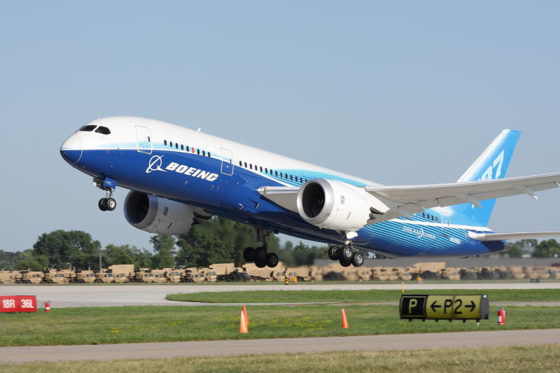 """Oshkosh, WI, USA - July 29, 2011: Brand new Boeing 787 Dreamliner in factory paint scheme taking off during EAA Airventure 2011."""