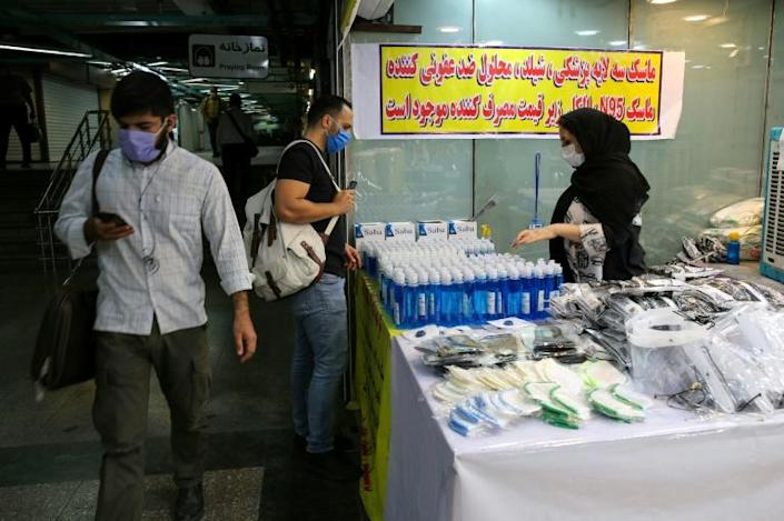The Islamic republic has been battling a resurgence of the virus, with official figures showing a rise in both new infections and deaths since a two-month low in May (AFP Photo/ATTA KENARE)