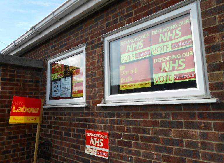 Opposition Labour party posters pictured on the windows of the Labour hall in Retford, Nottinghamshire on April 23, 2017