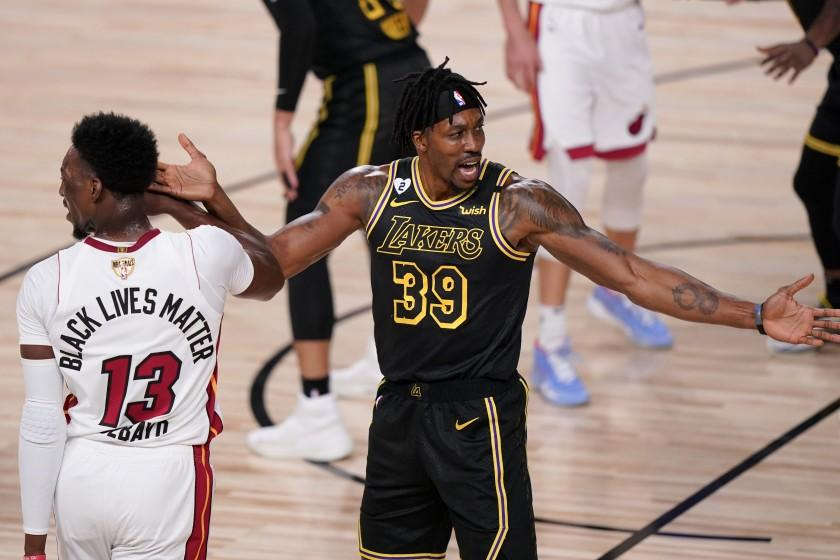 Los Angeles Lakers center Dwight Howard, right, reacts as Miami Heat forward Bam Adebayo.