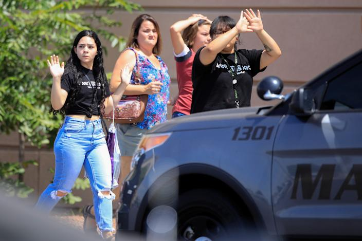 Shoppers exit with their hands up after a mass shooting at a Walmart in El Paso, Texas, August 3, 2019. (Photo: Jorge Salgado/Reuters)