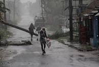 People are seen at the Chandabali and Dhamra area of Bhadrak district, 160 km away from the eastern Indian state Odisha's capital city as the Cyclone 'Amphan' cross the Bay of Bengal Sea's eastern coast making devastation on the cyclonic weather wind and rain and make landfall on the boarder of West Bengal and Bangladesh on May 20, 2020. (Photo by STR/NurPhoto via Getty Images)