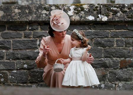 Britain's Catherine, Duchess of Cambridge stands with her daughter Princess Charlotte, a bridesmaid, following the wedding of her sister Pippa Middleton to James Matthews at St Mark's Church in Englefield, west of London, on May 20, 2017.    REUTERS/Kirsty Wigglesworth/Pool