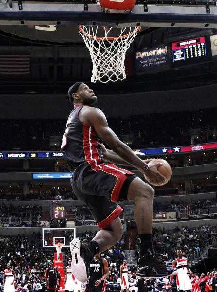 FILE - In this Oct. 15, 2013, file photo, Miami Heat forward LeBron James goes for a dunk during the first half of a preseason NBA basketball game against the Washington Wizards in Washington. Considered the best player in the game, James remains obsessed with getting better. That's why, on the verge of starting his 11th professional season and fourth with the Heat, he fully expects the 2013-14 campaign to be his best one yet. (AP Photo/Alex Brandon, File)