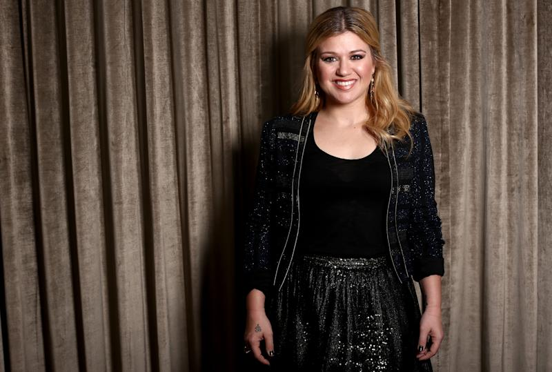 """In this Monday, Nov. 5, 2012 photo, musician Kelly Clarkson poses for a portrait in Los Angeles. Clarkson's newest album, Greatest Hits: Chapter One,"""" is releasing on Monday, Nov. 19, 2012. (Photo by Matt Sayles/Invision/AP)"""