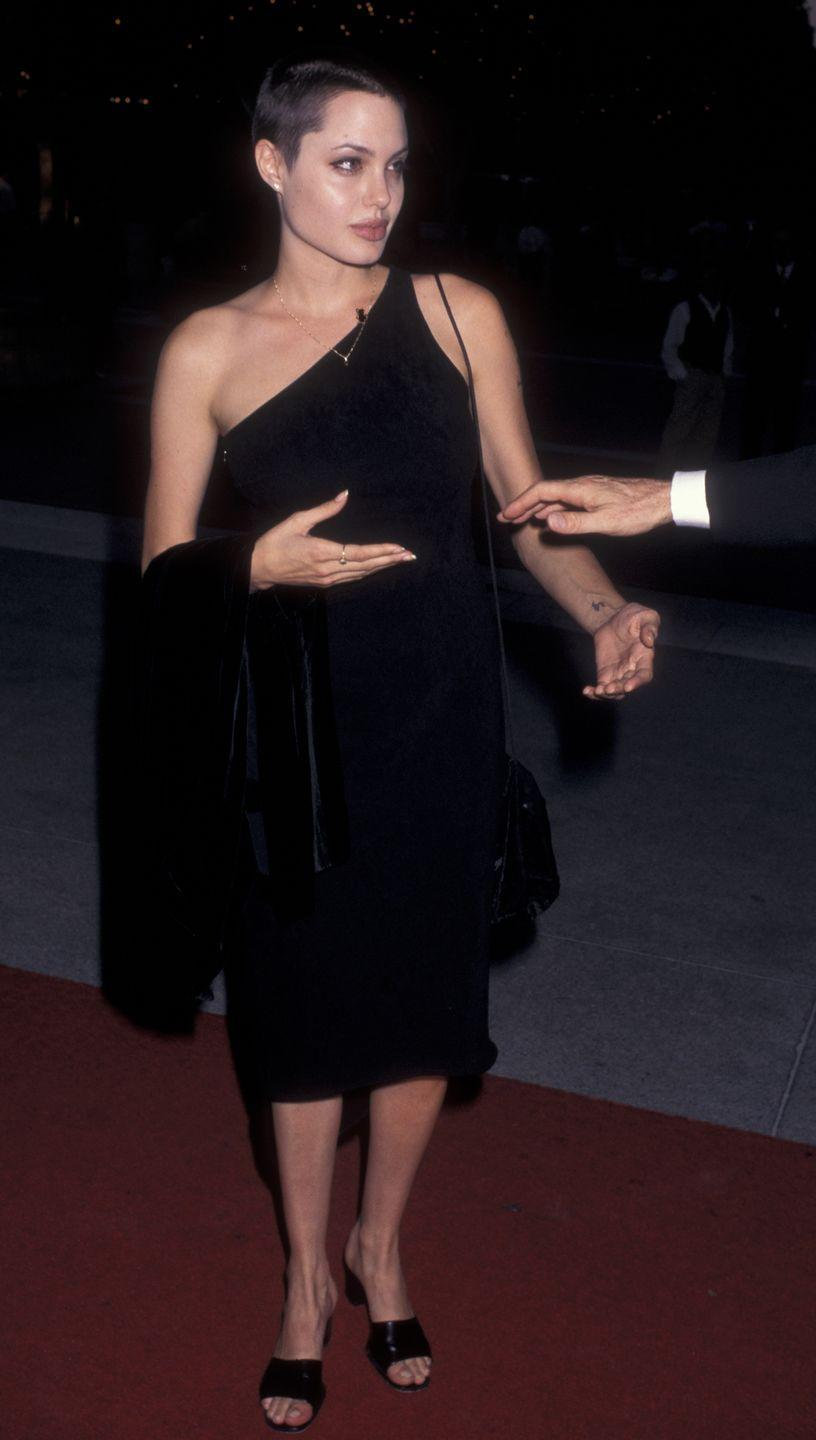 <p>Angelina Jolie shed her lengths to play tragic supermodel Gia Carangi in 1998. </p>