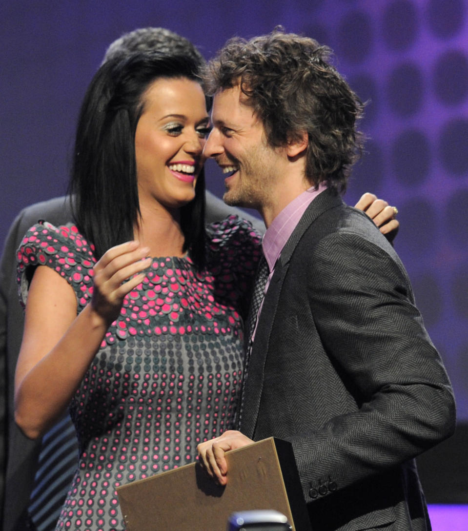 "FILE - Katy Perry, left, appears with Lukasz ""Dr. Luke"" Gottwald as he accepts the Songwriter of the Year award at the 27th Annual ASCAP Pop Music Awards in Los Angeles on April 21, 2010. Controversial music producer Dr. Luke was once pop music's top hitmaker, crafting hits for virtually every female pop star, from Katy Perry to Kelly Clarkson to Britney Spears. He returned to the charts in 2020 with Doja Cat's ubiquitous funk-pop jam ""Say So,"" along with Saweetie's anthemic bop ""Tap In"" and Juice WRLD's Top 5 pop smash ""Wishing Well."" He appeared as Tyson Trax on the Grammy ballot for Doja Cat's ""Say So,"" which he produced and co-wrote. The hit tune is competing for record of the year, where he is contention as the song's producer. (AP Photo/Chris Pizzello, File)"