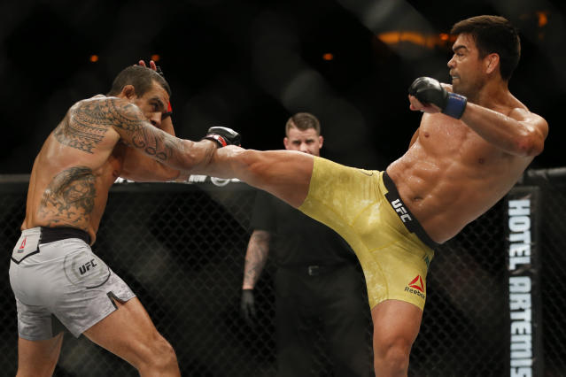 Vitor Belfort, left, announced his retirement on Saturday after taking a vicious knockout blow from fellow Brazilian Lyoto Machida in Rio de Janiero. (AP)