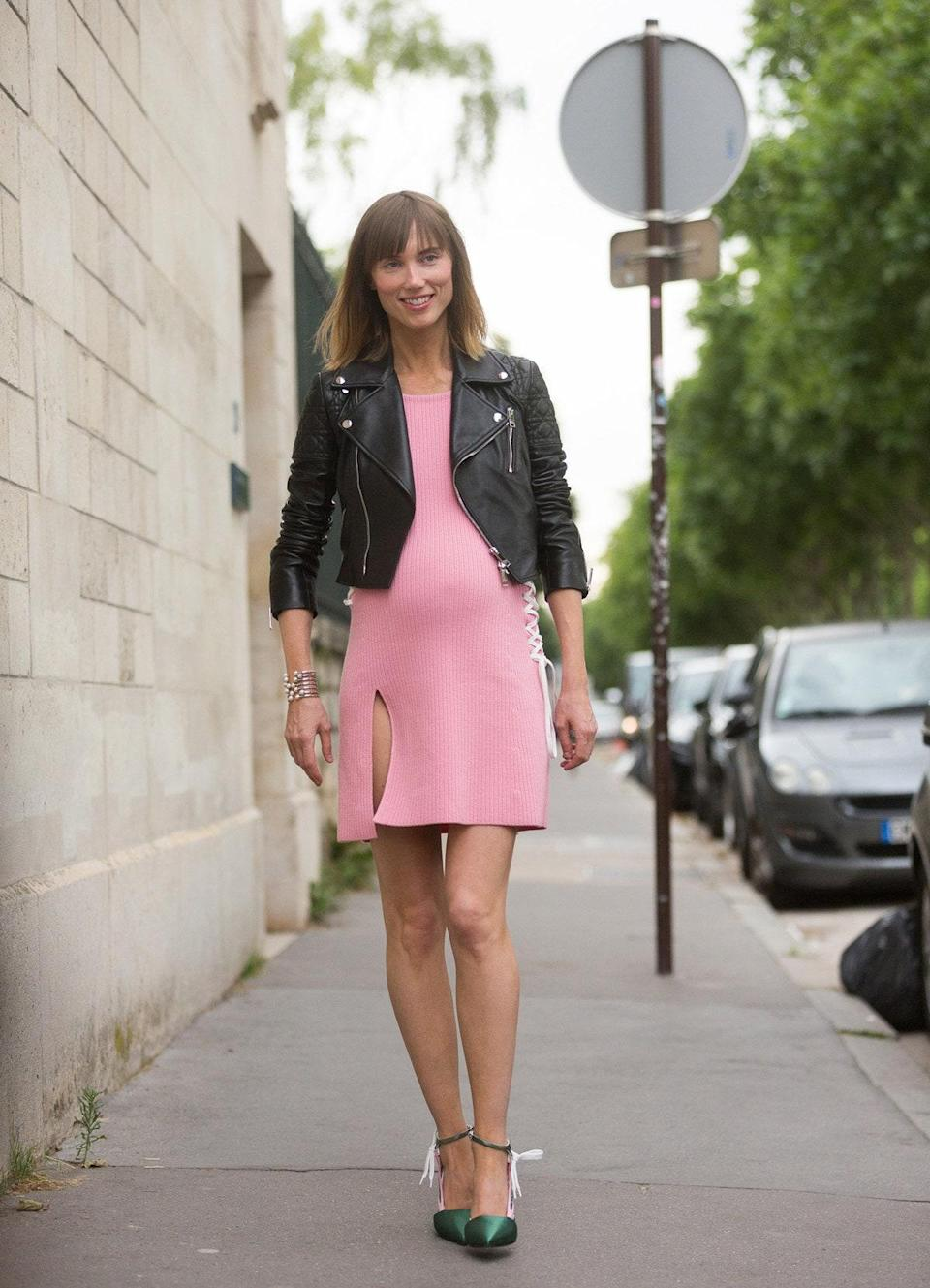 """<p>""""You will be surprised how many pieces you can wear well into your pregnancy,"""" says Nasiba Adilova, cofounder of <a href=""""https://www.thetot.com/"""" rel=""""nofollow noopener"""" target=""""_blank"""" data-ylk=""""slk:The Tot"""" class=""""link rapid-noclick-resp"""">The Tot</a>. """"Wear skirts higher up on your waist, or belt a dress to give yourself a waist again. Get creative!"""" <a href=""""https://www.instagram.com/heymichellelee/?hl=en"""" rel=""""nofollow noopener"""" target=""""_blank"""" data-ylk=""""slk:Michelle Lee"""" class=""""link rapid-noclick-resp"""">Michelle Lee</a>, editor-in-chief of <a href=""""https://www.allure.com/?mbid=synd_yahoo_rss"""" rel=""""nofollow noopener"""" target=""""_blank"""" data-ylk=""""slk:Allure"""" class=""""link rapid-noclick-resp""""><em>Allure</em></a><em>,</em> tells us that she found herself reaching for body-hugging dresses more and more when she was pregnant: The dress plus """"an eighties-like blazer, with sleeves pushed up to showcase wrists, which were my only [unaffected by pregnancy] body part after a while, and a low, chunky heel—that's an instant pregnant-lady work outfit.""""</p> <p>What's more, a trend or style (say, polka dots or maxi dresses) you might not typically gravitate toward might just become the MVP of your closet during those nine months: """"I loved wearing stripes when I got really large, which was odd, but I kind of loved how much it accentuated my giant belly,"""" recalls Stella Bugbee of her surprising pregnancy-wardrobe workhorse. """"I had a stretchy navy-and-white striped dress that became a long shirt when my stomach got to be super big.""""</p> <p>For <a href=""""https://www.instagram.com/chrisellelim/?hl=en"""" rel=""""nofollow noopener"""" target=""""_blank"""" data-ylk=""""slk:Chriselle Lim"""" class=""""link rapid-noclick-resp"""">Chriselle Lim</a>, <a href=""""http://thechrisellefactor.com/"""" rel=""""nofollow noopener"""" target=""""_blank"""" data-ylk=""""slk:blogger"""" class=""""link rapid-noclick-resp"""">blogger</a>, and founder of <a href=""""https://bumobrain.com/"""" rel=""""nofollow noopener"""" target=""""_blank"""" data-ylk=""""slk:BumoBrain"""" class=""""l"""