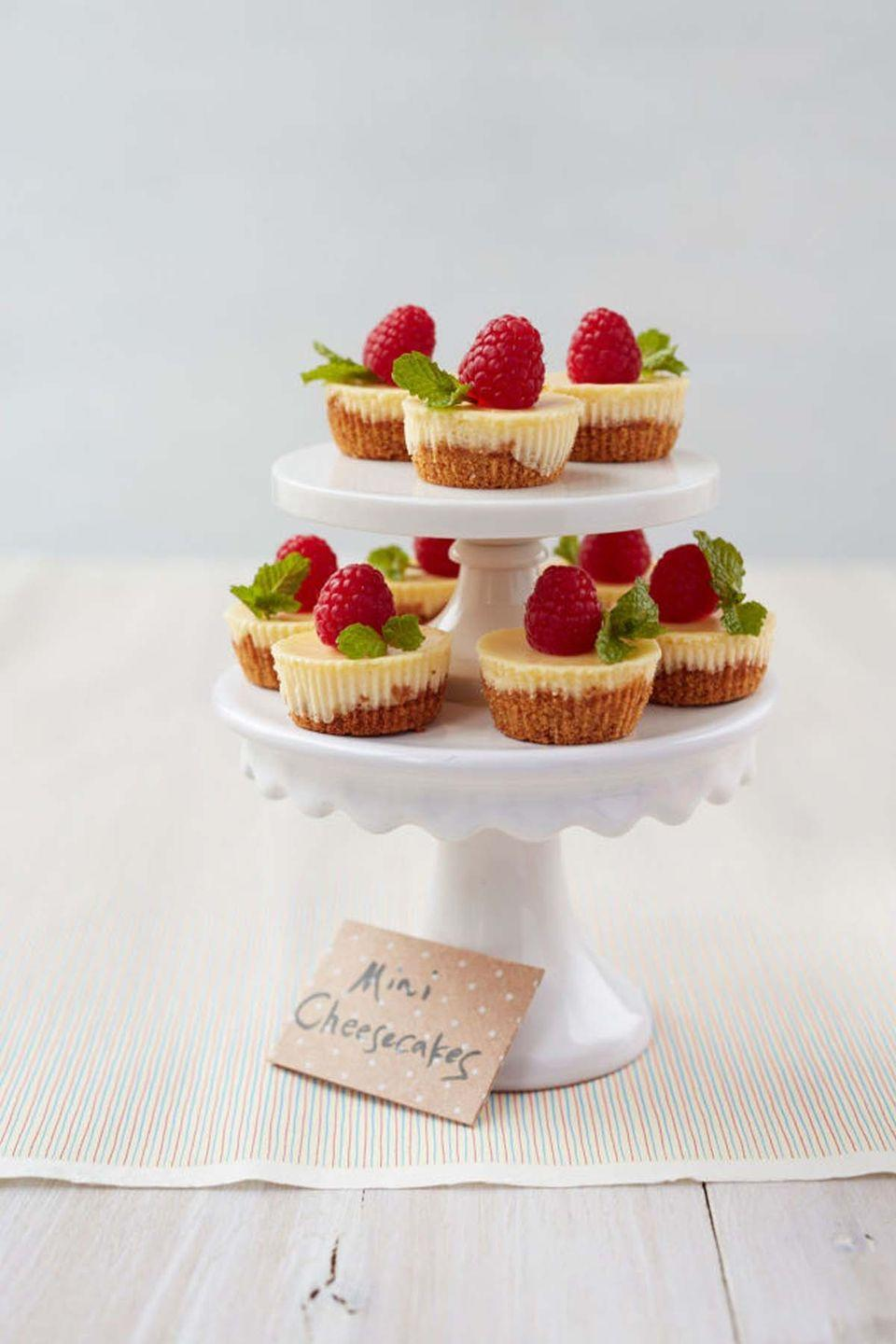 """<p>Personalize these miniature cheesecakes by topping them with mom's favorite fruits and candies. </p><p><a href=""""https://www.womansday.com/food-recipes/food-drinks/recipes/a39612/mix-match-mini-cheesecakes-recipe-ghk0514/"""" rel=""""nofollow noopener"""" target=""""_blank"""" data-ylk=""""slk:Get the recipe for Mix and Match Mini Cheesecakes."""" class=""""link rapid-noclick-resp""""><em>Get the recipe for Mix and Match Mini Cheesecakes.</em></a><br></p>"""
