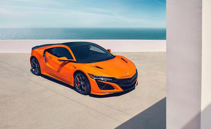 """<p>The <a href=""""https://www.caranddriver.com/news/a22812058/2019-acura-nsx-supercar/"""" rel=""""nofollow noopener"""" target=""""_blank"""" data-ylk=""""slk:mildly updated 2019 Acura NSX"""" class=""""link rapid-noclick-resp"""">mildly updated 2019 Acura NSX</a> is all about performance, not fuel economy. It uses not one, not two, but <em>three </em>electric motors to aid its twin-turbocharged V-6 engine. The combination, in which one motor directly works with the engine to drive the rear wheels, and another two power the front wheels, is powerful enough to propel the NSX from zero to 60 mph in only 3.1 seconds. Should you prefer to cruise in a more subtle, eco-friendly manner, the EV drive mode allows <a href=""""https://www.caranddriver.com/acura/nsx"""" rel=""""nofollow noopener"""" target=""""_blank"""" data-ylk=""""slk:the NSX"""" class=""""link rapid-noclick-resp"""">the NSX</a> to run a limited distance on electric power alone.<br></p>"""