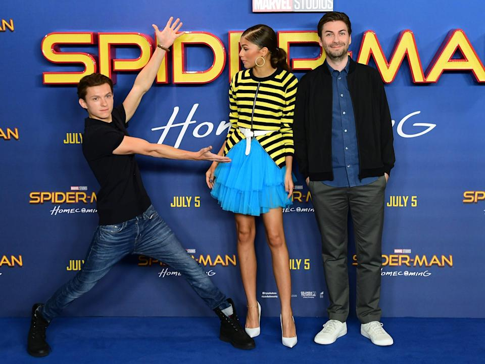 """Tom Holland, Zendaya, and Jon Watts posing at a photocall for """"Spider-Man: Homecoming in June 2017."""