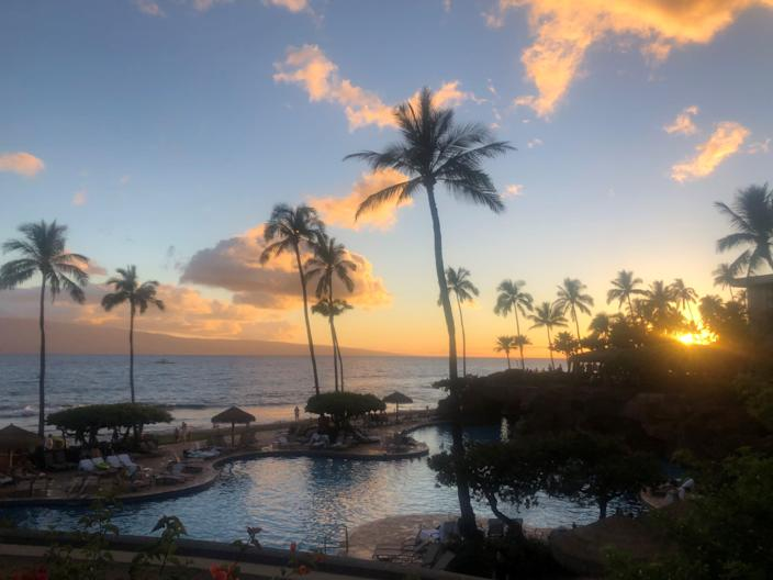 Sunset views from the Hyatt Regency Maui in Hawaii, with the island of Lanai in the distance.