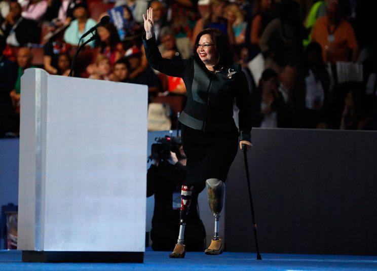 Tammy Duckworth waves to supporters