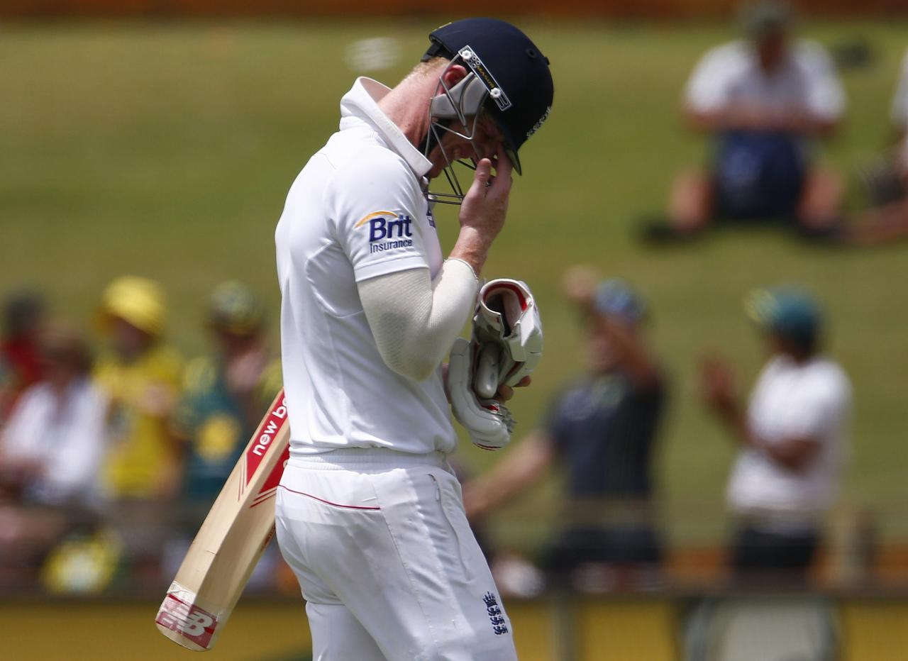 England's Ben Stokes reacts as he walks off the field after he caught out by Australia's wicket-keeper Brad Haddin during the fifth and final day of the third Ashes test cricket match at the WACA ground in Perth December 17, 2013. REUTERS/David Gray(AUSTRALIA - Tags: SPORT CRICKET)