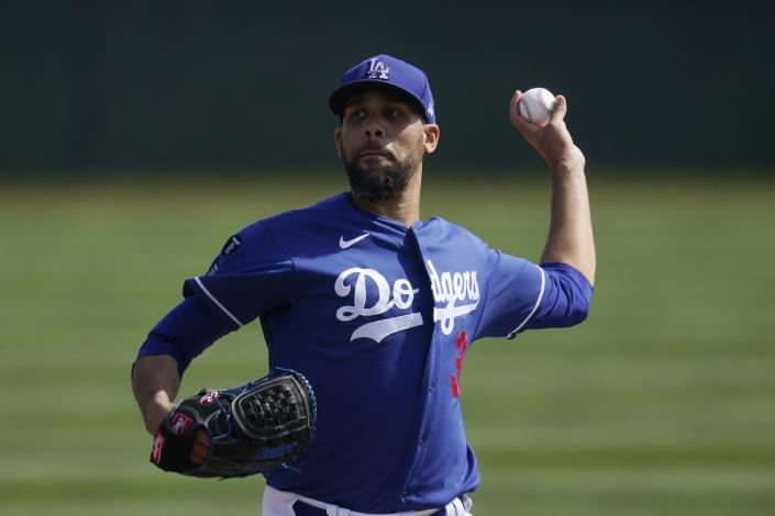 Los Angeles Dodgers starting pitcher David Price throws a mock pitch as pitchers take infield drills during a spring training baseball practice Tuesday, Feb. 23, 2021, in Phoenix. (AP Photo/Ross D. Franklin)