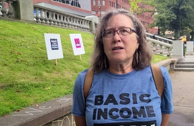 Mandy Kay-Raining Bird, chair of Basic Income Nova Scotia, speaks during a rally at Halifax's Grand Parade on Saturday. (Haley Ryan/CBC - image credit)