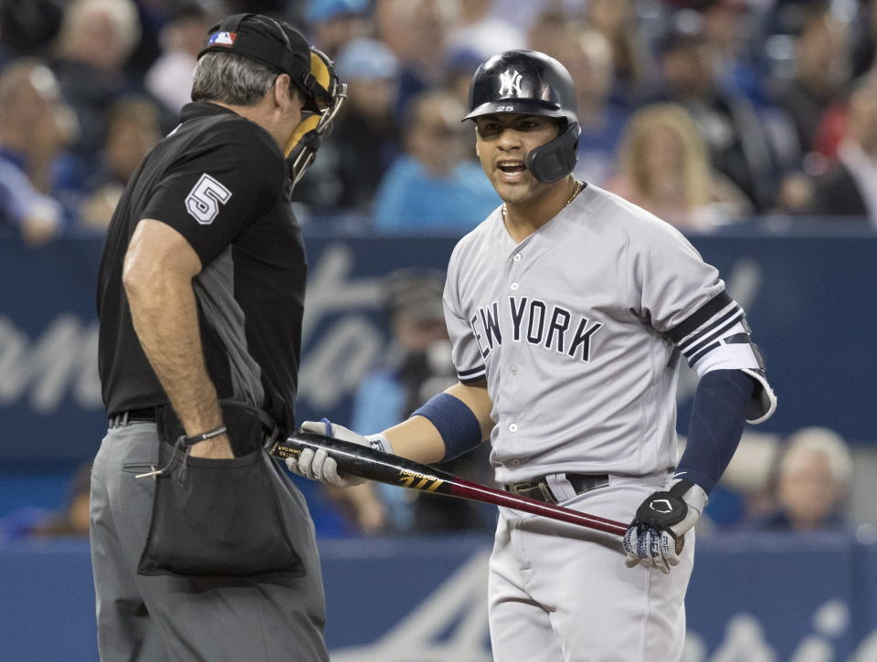 New York Yankees' Gleyber Torres argues a called strike with home plate umpire Angel Hernandez during the second inning of the team's baseball game against the Toronto Blue Jays in Toronto on Tuesday, June 4, 2019. (Fred Thornhill/The Canadian Press via AP)