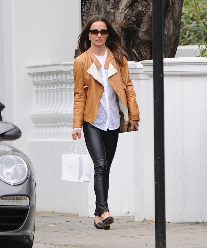 <p>A week before her wedding, Pippa was spotted on the streets of London in skintight leather trousers and a tan leather jacket. <i>[Photo: FameFlynet]</i></p>