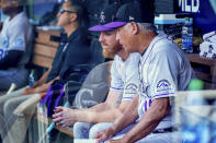 Colorado Rockies manager Bud Black, right, speaks with starting pitcher Jon Gray, left, in the dugout during the fifth inning of a baseball game against the Washington Nationals at Nationals Park, Sunday, Sept. 19, 2021, in Washington. (AP Photo/Andrew Harnik)