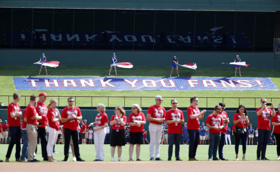 A sign past center field thanks fans on behalf of the Texas Rangers before a baseball game against the New York Yankees in Arlington, Texas, Sunday, Sept. 29, 2019. The Rangers are playing their final game at Globe Life Park before moving over to their new facility across the street for the 2020 season. (AP Photo/Tony Gutierrez)
