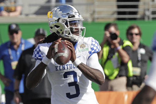 FILE - In this Jan. 1, 2019, file photo, Kentucky quarterback Terry Wilson (3) looks for a receiver against Penn State during the first half of the Citrus Bowl NCAA college football game in Orlando, Fla. (AP Photo/John Raoux, File)