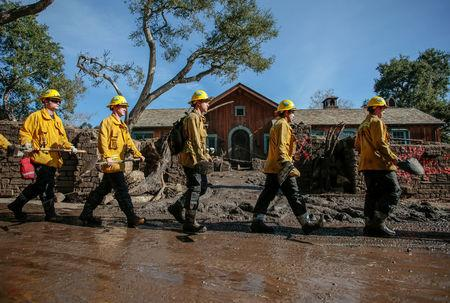 Rescue workers enter properties to look for missing persons after a mudslide in Montecito, California, U.S. January 12, 2018.  REUTERS/ Kyle Grillot