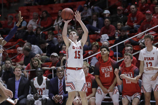 Utah guard Rylan Jones (15) shoots a 3-pointer against UC Davis during the second half of an NCAA college basketball game Friday, Nov. 29, 2019, in Salt Lake City. (AP Photo/Rick Bowmer)
