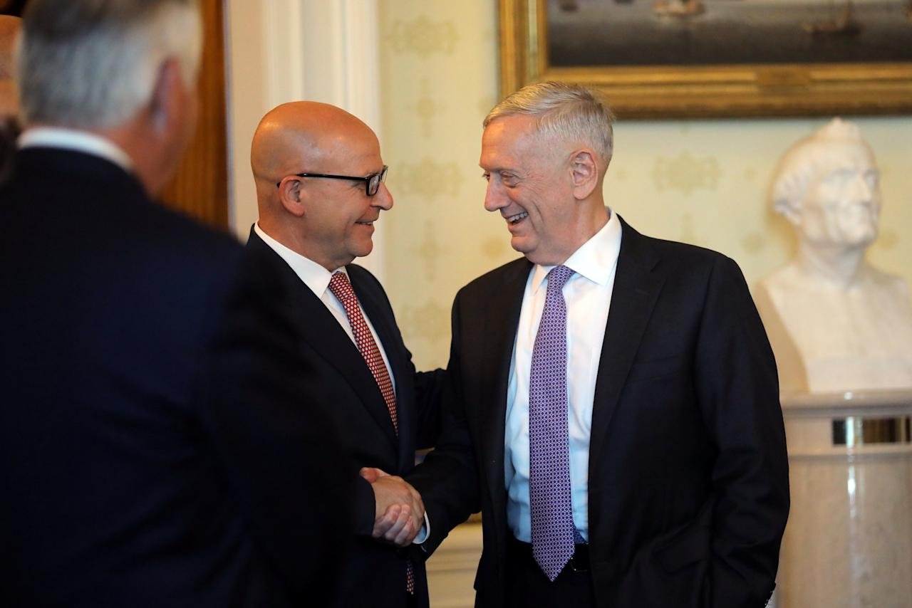 Secretary of Defense James Mattis (R) shakes hands with White House National Security Advisor H.R. McMaster as they attend a dinner hosted by  U.S. President Donald Trump (not pictured) welcoming Indian Prime Minister Narendra Modi (not pictured) at the White House in Washington, U.S., June 26, 2017. REUTERS/Carlos Barria