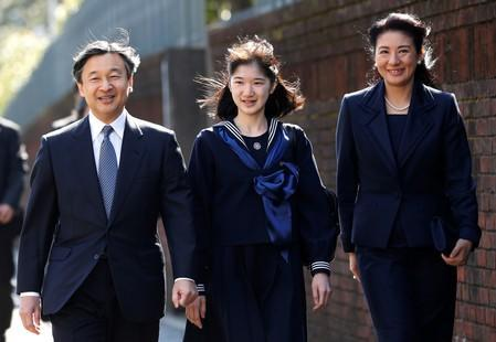 FILE PHOTO: Japan's Princess Aiko, accompanied by her parents Crown Prince Naruhito and Crown Princess Masako, arrives at her graduation ceremony at the Gakushuin Girls' Junior High School in Tokyo